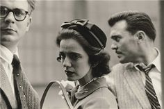 Dianne Arbus - A Woman on the Street with Two Men, N.Y.C., 1956