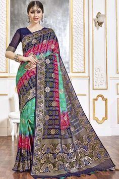 Multi Color viscose saree with blue viscose blouse. Embellished with woven zari work. Saree with V Neck, Elbow Sleeve. It comes with unstitch blouse, it can be stitched to 32 to 58 sizes. #weddingsaree #weddingwearsaree #festivalwear