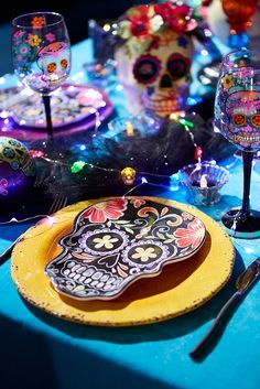 Create a spooky, kooky table by mixing Pier 1's Dia de los Muertos Skull Melamine Salad Plate with solid-color dinnerware. It's made of printed BPA-free melamine with a white underside, so just add blue, purple, orange or black linens, plus a fun centerpiece or a few candles, and you'll be set for a terrorific meal.