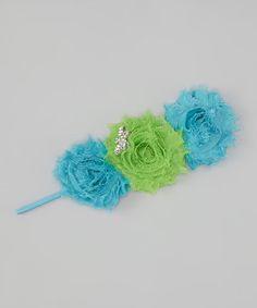 Like a beautiful garden, this lovely headband is blooming with perfection. The wispy bouquet of flowers is adorned with a rhinestone dragonfly that adds an elegant flair to any ensemble.13'' circumferencePolyester blendMade in the USA