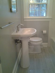 my finished bathroom. plank tiles, dolphin paint by martha stewart, cimarron toilet & sink by kohler, recessed medicine cabinet by pottery barn