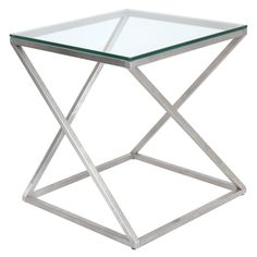 "Create an artful appeal in your living space with the 4Z side table. An intricately twisted chrome base supports an elegant glass table top providing function to this visually alluring piece. 20.5""L x"