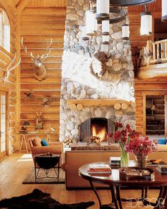 massive chimney constructed from local river rocks serves as a focal point in the great room, while hunting trophies are hung on the log-lined walls