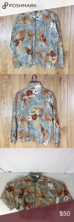 Kaktus Petite Windbreaker Jacket Floral MP Medium This beautiful vintage windbreaker is in excellent pre-owned condition!! Both shell and lining are made of 100% polyester.  The measurements are: Armpit to armpit 25 inch, Sleeve length 20 inch, Waist 22 inch, Length 24 1/2 inch. Please feel free to ask any questions you have. All reasonable offers will be accepted. Buy with Confidence!! Kactus Petite Jackets & Coats