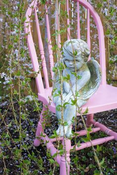 Imagine having this beautiful Garden angel and soothing pink chair tucked away into a garden of tall flowers - lovely!