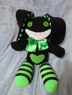 Original bunny rabbit plushie (35 cm high), goth lolita punk emo fashion cosplay, black with green + green button eyes on Etsy, $28.01 CAD