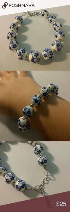 Blue Flower Bracelet Beautiful hand painted ceramic beads. White with a blue floral design and small silver beads. Very elegant bracelet.  Will fit a 6 to 8 inch wrist. The bracelet itself is 7.5 to 9 inches. Diamonds&Jules Jewelry Bracelets