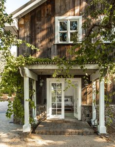 Light and Airy California Farmhouse The outside of today's California farmhouse embraces rustic appeal with its rough-hewn siding. You'll be delighted by its light and airy interior spaces.