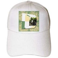 A 3DRepousee with green, tan and white with focus on palm trees Cap