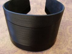 Roman Record Cuff: Made from a repurposed record. Basic black with cool grooves of hidden music.