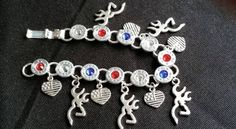Become one of the few 40 Caliber Aluminum Buck/Heart Charm Bracelet Red/White/Blue