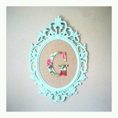 Ikea frame painted with fabric covered wooden letter--would be so cute in my little girl's room!