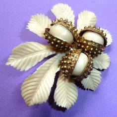 Celluloid brooch with horse chestnut leaves and 3 conkers!  £48  www.gillianhorsup.com -   Photograph by Gillian Horsup