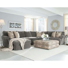 Grey sectional with light blue walls Bradley Sectional. Not a fan of the light blue walls.