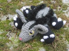 Pokemon Inspired: Mightyena Amigurumi Crochet by TheTallGrass  Handmade plushie (in crochet Amigurumi style) of the dark type, Mightyena, from Pokemon!   Mightyena measures 9in long, 4in tall and 8in wide. He is stuffed with polyfil stuffing and his eyes/detailing are needle-felted on and his glorious main is fluffed out yarn to fully capture the majesty of this fierce dark Hyena-Wolf Pokemon.