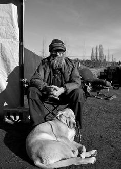 In an earlier post, Victoria Caldwell had asked about Coffee John and his lovely dog Mississippi. Here they both are, soaking up some Seattle sun in Tent City 3.  Queen Anne 2/4/2012