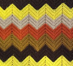Hand-Crocheted Afghan Blanket: Chevron Pattern in Orange, Tan, Yellow and 3 Shades of Brown by HautelAudubon on Etsy https://www.etsy.com/listing/468297961/hand-crocheted-afghan-blanket-chevron