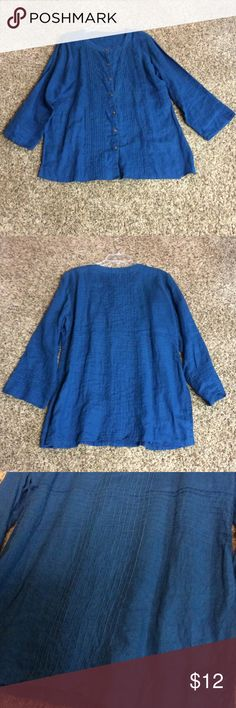 """Plus-sized dark blue shirt There are no tags.  Measures flat arm pit to arm pit 24 1/2"""", shoulder to hem 31""""and sleeves are shoulder to wrist 22 1/2"""".  The sleeves are 9"""" wide at the arm pit and tapper to 7 1/2"""" at wrist.  The side seam has a 9"""" slit at the bottom edge. Cotton.  Picture #3 in the lower right corner shows a defect in fabric, looks like a little knot.  To me the blue is more teal than photos show.  EUC Tops Button Down Shirts"""