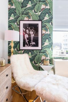 The softness of the sheepskin against the bright green of the Martinique Banana Leaf wallpaper, well known from the Beverly Hills Hotel, works perfectly here - a way of using Pantone's Colour of the Year, Greenery.