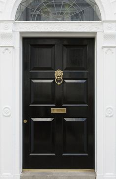 27 Pictures of Black Front Doors (Front Entry) This stately black door features deep panels and brass details, including lock cylinder, mail slot, and lion head knocker. Black Entry Doors, Black Exterior Doors, Modern Entrance Door, Entrance Doors, House Entrance, Front Door Design, Front Door Colors, Front Door Decor, House Doors