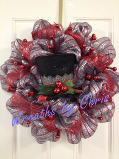 Wreaths by Chris https://www.etsy.com/shop/WreathsByChris Frosty's Top Hat on a winter wreath of silver and red deco mesh. Top hat and work wreath base purchased from http://www.trendytree.com #trendytree #christmaswreath