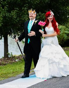 """Disney themed wedding - the bride as Ariel with her father walking her down the aisle as King Triton with accompanying music from the Little Mermaid movie, """"Part of Your World."""""""