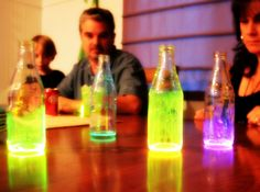 Cut open a glowstick and shake it into an empty bottle.  Whirl and swirl it around for fun glow in the dark colors.  You can also add some water or oil to the jar to give it bigger and a more even color.