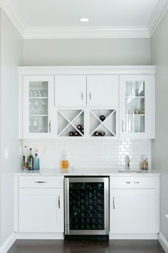 White Window Front Cabinets Create A Ger Feel In This Custom Wet Bar