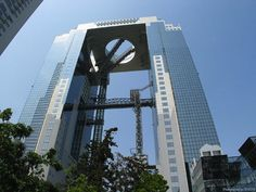 Located in Osaka, the Umeda Sky Building is actually the byproduct of 2 interconnected skyscrapers. The building consists of two 40-story towers that meet at the highest level and the 2 buildings are connected with bridges & an escalator which is the 12th tallest in Osaka.