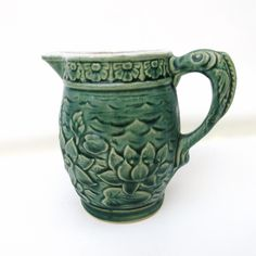 Vintage McCoy Pottery Pitcher, Green Lotus Flower, Small Pitcher, Water Lily Milk Pitcher,  Fish Art Handle by WhimzyThyme on Etsy #etsyfinds #livesimple #dscollections