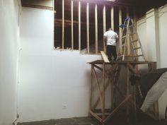 Oscar building a wall to separate the photo studio from the back area
