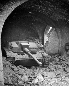 Armor in the lobby: A German Sturmgeschutz 40 (StuG 40) self-propelled gun takes cover in the lobby of the Continental Hotel in Cassino, Italy that has been bombed to destruction by US forces, May 19, 1944. #worldwar2 #tanks