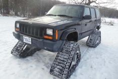 Autotrader Find: 2001 Jeep Cherokee With Snow Tracks 2001 Jeep Cherokee, Jeep Cherokee Sport, Rear Differential, Jeep Models, Wheels And Tires, Used Cars, Monster Trucks, Track, Ford