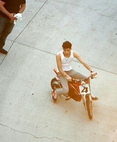 Zayn on some sort of motorbike/bike/motorcycle....something that has wheels. I love it.  -H