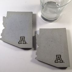 *Licensed Product* These coasters are in the shape of Arizona, with a heart and the University of Arizona logo over Tucson.  The coasters measure