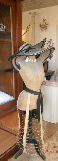 Love this dress form... striking image with tailors dummy and hats Repinned by www.silver-and-grey.com