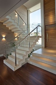 19 Modern And Elegant Stair Design Ideas To Inspire You : Quarter Landing Stairs In White Color With Metal Hand Railing Along With Glass Rails Also Wooden Floor