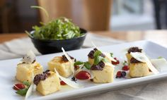 Gnocchi Romana with olive tapenade, tomato and harrisa puree, dressed rocket, micro basil and 'parmesan'.  FFFx