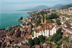 Neuchatel, Switzerland. Great place to visit.  Swiss Alps in the background and great little places to see while there.