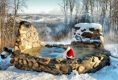 Wood-fired stone masonry hot tub.