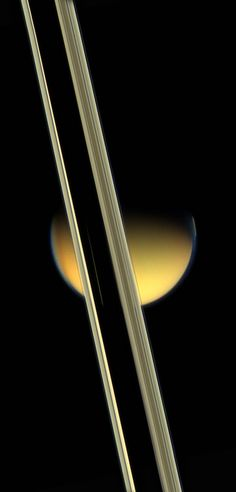 In this image from NASA's Cassini spacecraft, Saturn's rings obscure part of Titan's colorful visage.