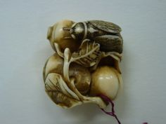 Netsuke carved wood chrysanthemum carved wood rodents