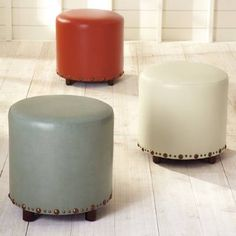 Solve all those surface and seating needs with our Dani Ottoman. Impeccably crafted of leather into a smooth cylinder, this versatile ottoman has a use in    every room. It handsomely serves as a footrest, tray table or extra seating.            Attractive leather ottoman in a timeless cylinder shape                Nailhead trim at the bottom edge                Sits on short wooden legs                Simple assembly                Imported