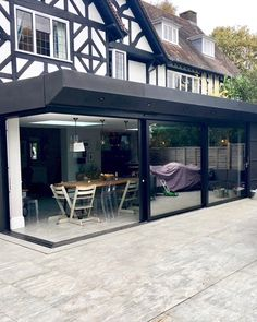 An Impressive Cornerless Sliding Door on this Home in Woking finished in Matt Black. A great way to open up your Property for the Summer Months Aluminium Sliding Doors, Aluminium Windows, Summer Months, Front Design, Open Up, Surrey, Diy Projects, Outdoor Decor, Black