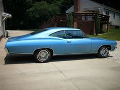 1967 Chevrolet Impala SS- I had a 1967 Impala 2 dr. hardtop this color that we drove on our honeymoon.