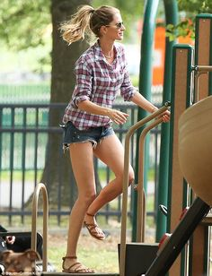 The leggy look: Gisele teamed her denims with a loose-fitting checked shirt and flat, tan ...