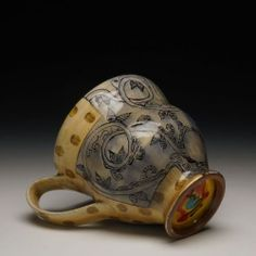 Artist Adero Willard was inspired by textiles, is is evident in this mug.  -- his work reminds me of some ceramicists who have come out of UF program, but I can't find any evidence of that.
