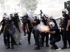 Turkish police fire tear gas, water cannon at May Day protesters