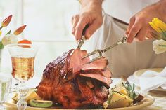 Sweet-Hot Plum-Glazed Ham - Classic Main Dishes for Your Easter Dinner - Southernliving. Plum preserves spiked with fresh citrus, ginger, and crushed red pepper update the traditional Easter ham. Garnish with tropical fruits like kiwi and pineapple for a fresh look.  Recipe:Sweet-Hot Plum-Glazed Ham