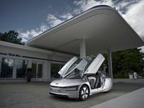 Volkswagen XL1....Super Light  and Super striped down...extremely aerodynamic.....electric and diesel powered to 262 MPG
